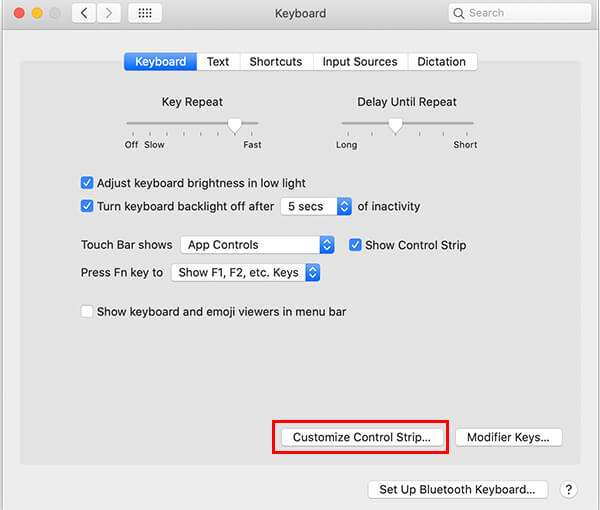Click Customize Control Strip on MacBook Pro